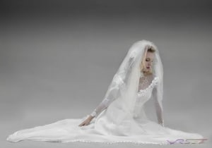 fashion-photographer-los-angeles-orange-county-model-wedding-gown-sitting-white-studio