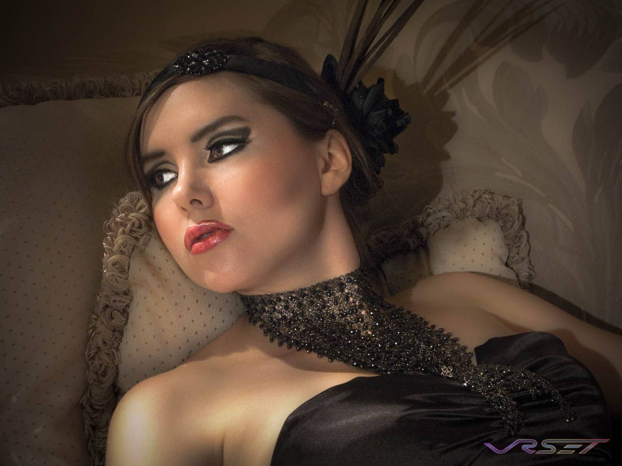 reclining glamor photo female model ornate neck piece