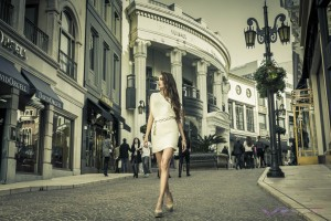International model Tala Golzar wearing a short sleeveless ivory dress accented by large chain link gold belt on Rodeo Drive, Beverly Hills California, by Top Fashion Photographer Los Angeles Orange County Video Production David Victory