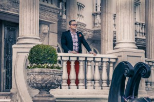 Public Relations Tycoon looking out at chateau in Beverly Hills, portrait by top fashion photographer Los Angeles & Orange County Video Production David Victory