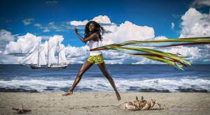 """Chasing a black hull schooner with the 6'1"""" supermodel Cole Woods on a picturesque California beach, while photographing Junniah NY island wear by fashion designer Martine Pesch"""