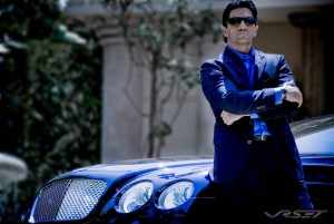 Model photographer in Orange County. A male model wearing dark blue suit next to a midnight blue Bentley Continental GTC convertible