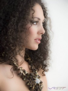 Headshot photography in O.C. I used a single large natural light source to illuminate this bust shot of the model with curly hair, the lighting minimized retouching
