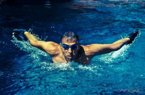 Butterfly stroke is the toughest swim, and I captured the moment with a Canon telephoto lens focusing every millisecond to perfection. Photography by photographer in Orange County
