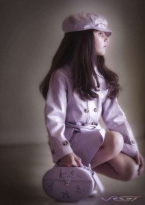 Cute is an understatement for this little girl wearing a lavender raincoat, dramatized by use of vignette and background blur. Portrait photography in O.C.